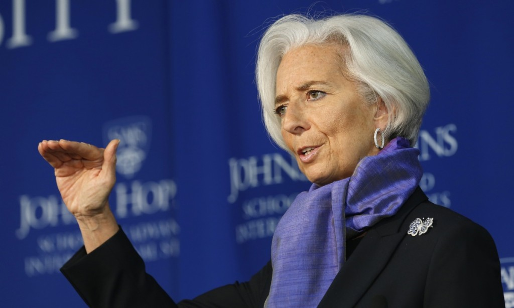 "International Monetary Fund Managing Director Christine Lagarde gestures as she speaks about the global economy at the Johns Hopkins School of Advanced International Studies in Washington April 2, 2014. The European Central Bank should ease monetary policy to combat the risk of ""low-flation"" that could crimp euro zone output and consumer spending, the head of the International Monetary Fund said on Wednesday. REUTERS/Kevin Lamarque (UNITED STATES - Tags: POLITICS BUSINESS EDUCATION) - RTR3JO26"